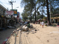 Patong's beach road is covered in sand and debris