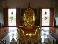 The golden Buddha image emerging from the ground at Wat Phra Thong